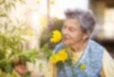 lady smelling flowers.jpg