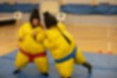 kids playing sumo suit wrestling