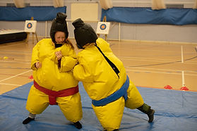 kids playing sumo suit wrestling