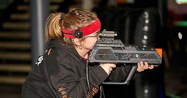 girl playing laser tag