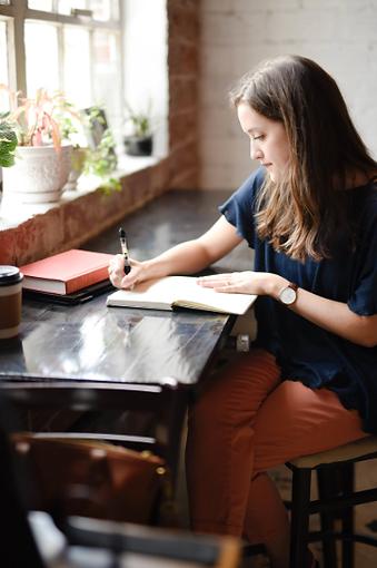 Girl Writting-Upsplash.png
