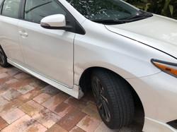 pearl white toyota prius fender and door autobody damage