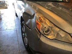 Subaru Outback bumper fender autobody damage
