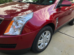 3 stage red cadillac SRX fender damage repaired