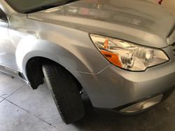 Subaru Outback bumper fender autobody damage repaired
