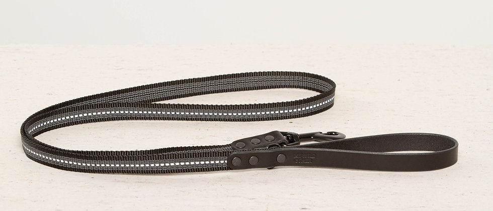 Reflective, rubber covered black leather dog leash
