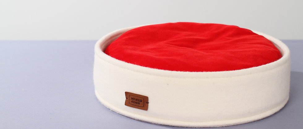 Wool felt low round bed with funky pillow