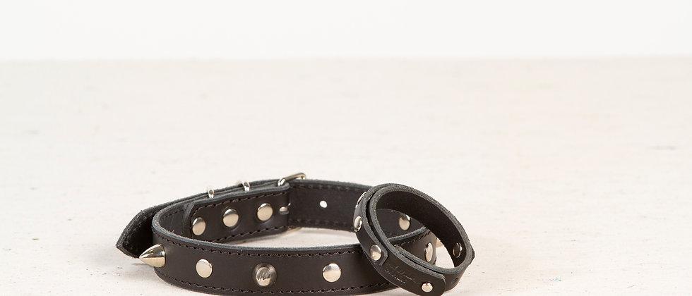 Human's wristband spikes on black