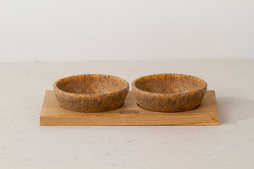 Pair of matte brown handmade ceramic dog bowls with oak tray