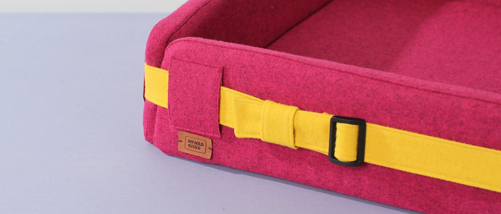 Wool upholstered, orthopedic dog bed. Pink and foldable
