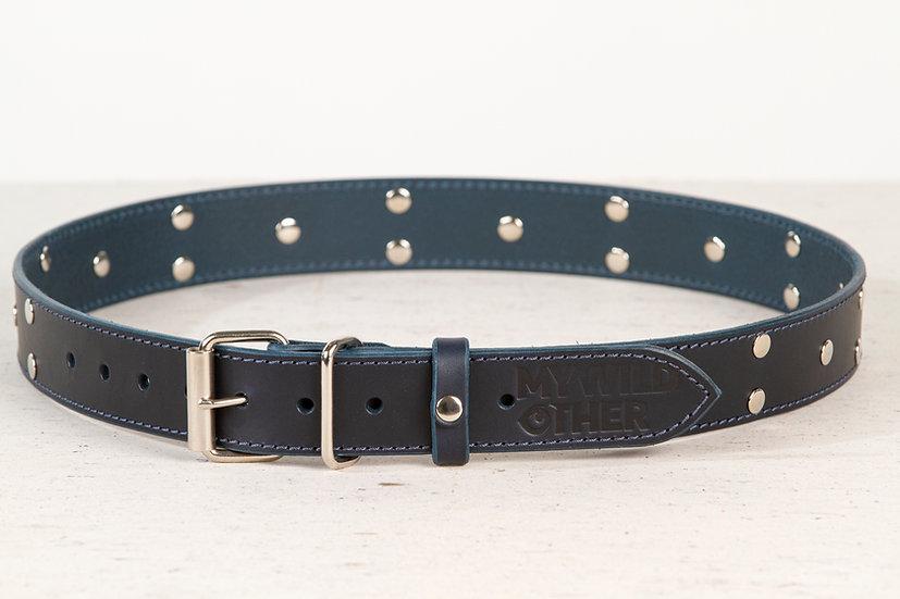 Human's belt spikes on blue
