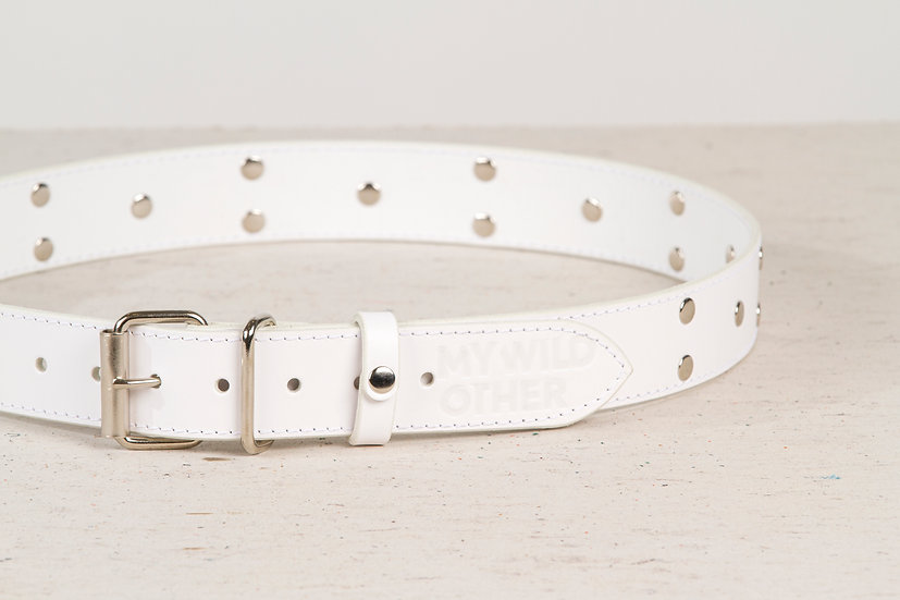Human's belt spikes on white