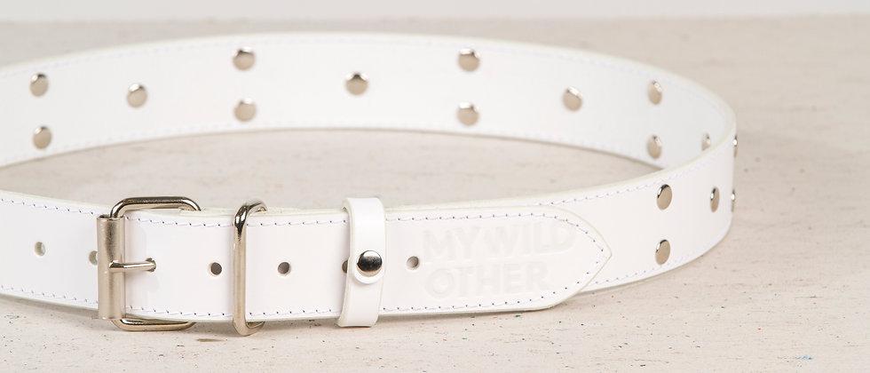 Human's belt spikes on white
