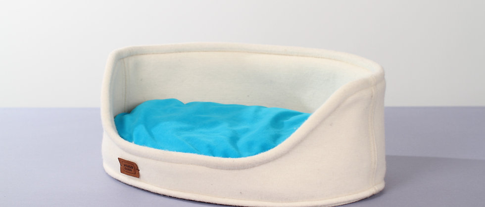 Wool felt high oval cut bed with funky pillow