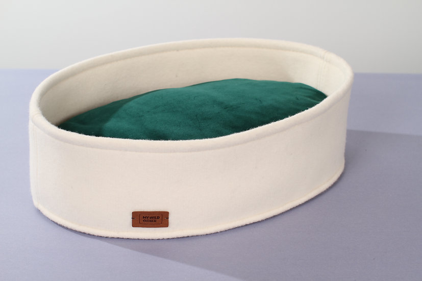 Wool felt high oval bed with funky pillow