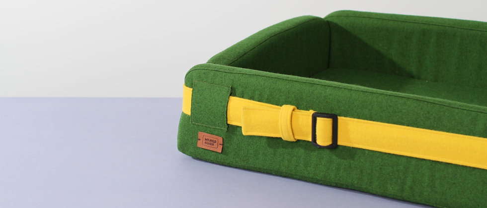 Wool upholstered, orthopedic dog bed. Green and foldable