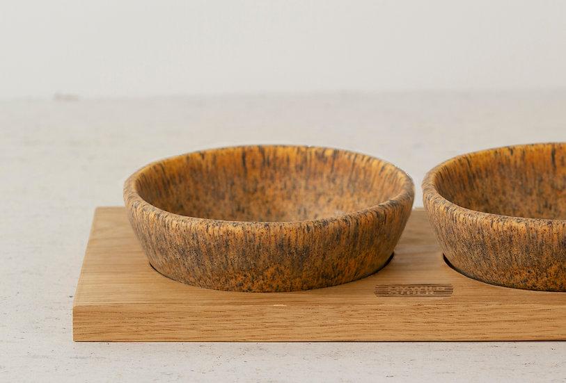 Pair of matte brown handmade ceramic cat bowls with oak tray