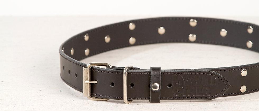 Human's belt spikes on black