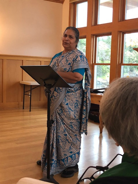 Indian woman speaking at a podium