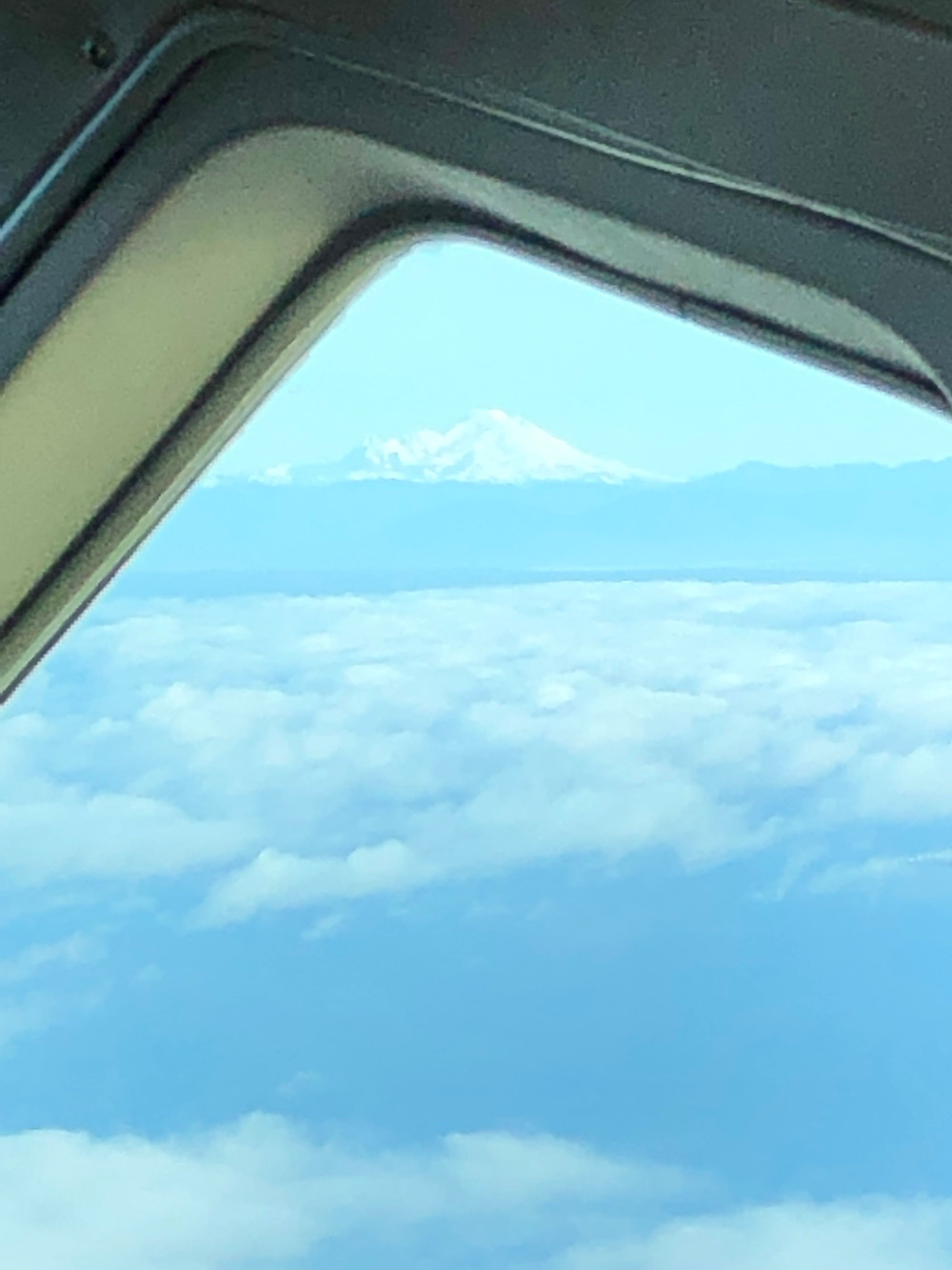 Photo of Mt Baker from the airplane window