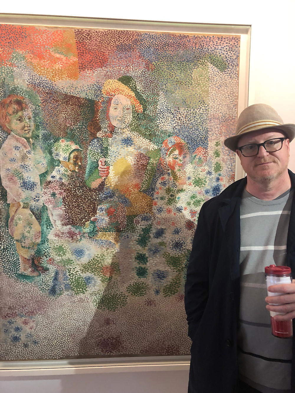Mike poses with the cheerful pointillism painting