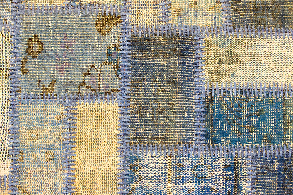 Patchwork quilt with thick blue threading