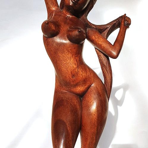 Naked girl carved on wood