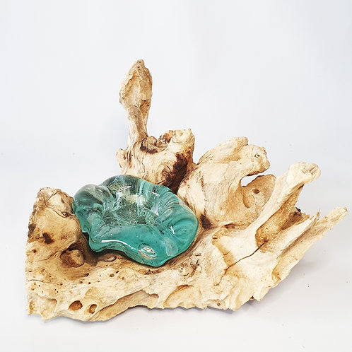 Glass ashtray melted on the wood #3