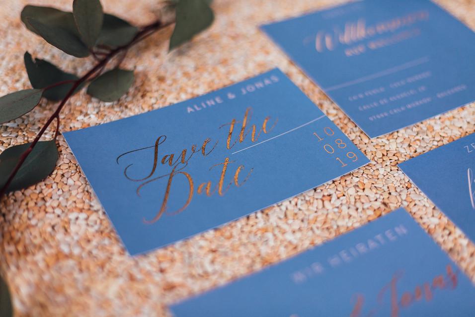 Hochzeitspapeterie blau und gold