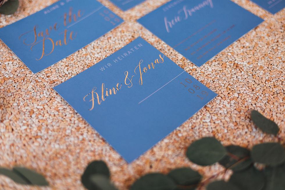 Hochzeitspapeterie blau und rosegold