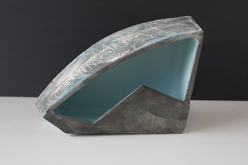 Medium ceramic sculpture with blue open inside
