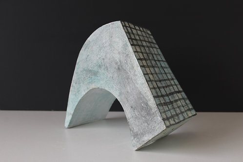 Large solid arched blue ceramic sculpture