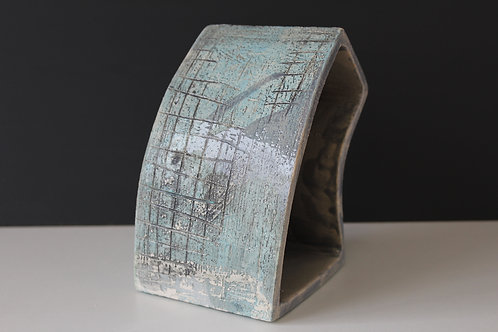 Medium open ceramic sculpture with blues & greens