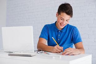 teen-boy-doing-homework.jpg