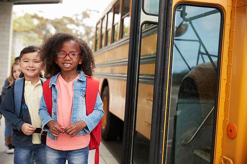 smiling-elementary-school-kids-queueing-