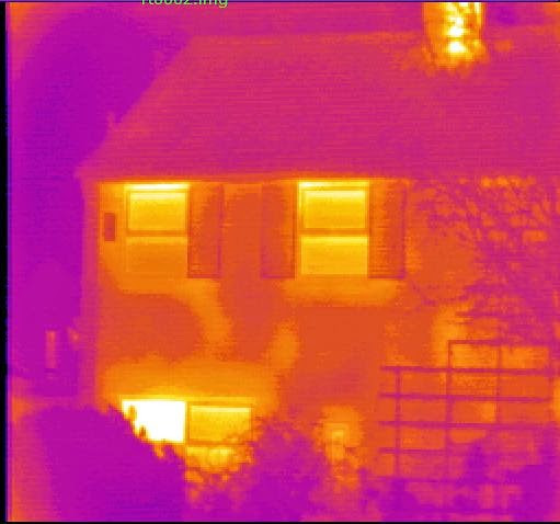This is the thermal image of a house with very poor insulation and glazing.