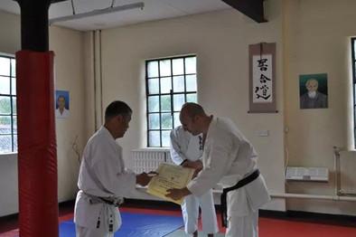 Sensei Mark receiving his 2nd Dan certificate by Sakagami Sensei
