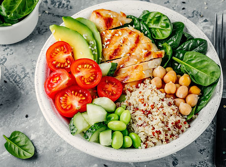 Buddha bowl with spinach salad, quinoa,