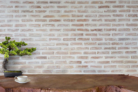 Mock up wooden table with white brick wall. For product display montage.jpg