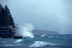 Winter_wave_over_boathouse_Captain_Johns