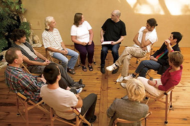 People sit in a group circle to talk.