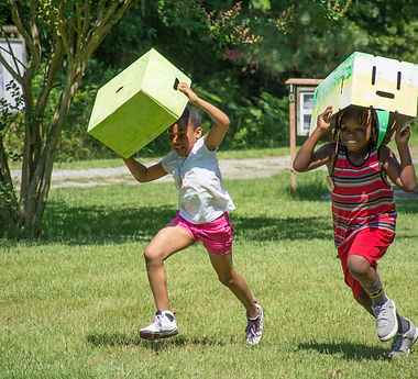 Kids running with boxes on their heads