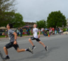 Two boys running at a race