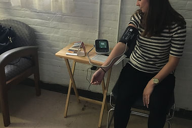 Woman getting her blood pressure monitored.