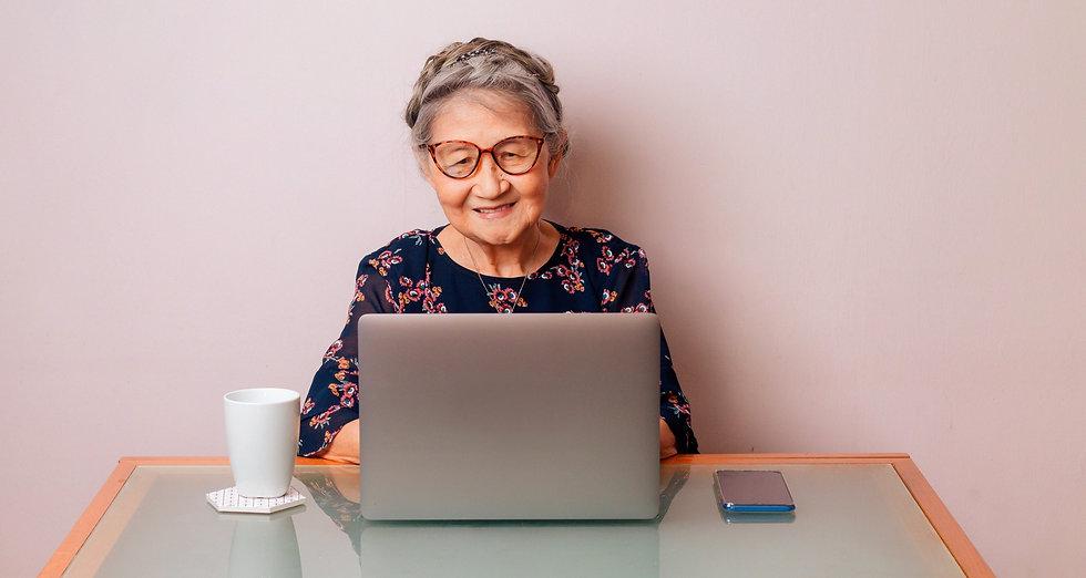 Older lady using Skillet on her laptop