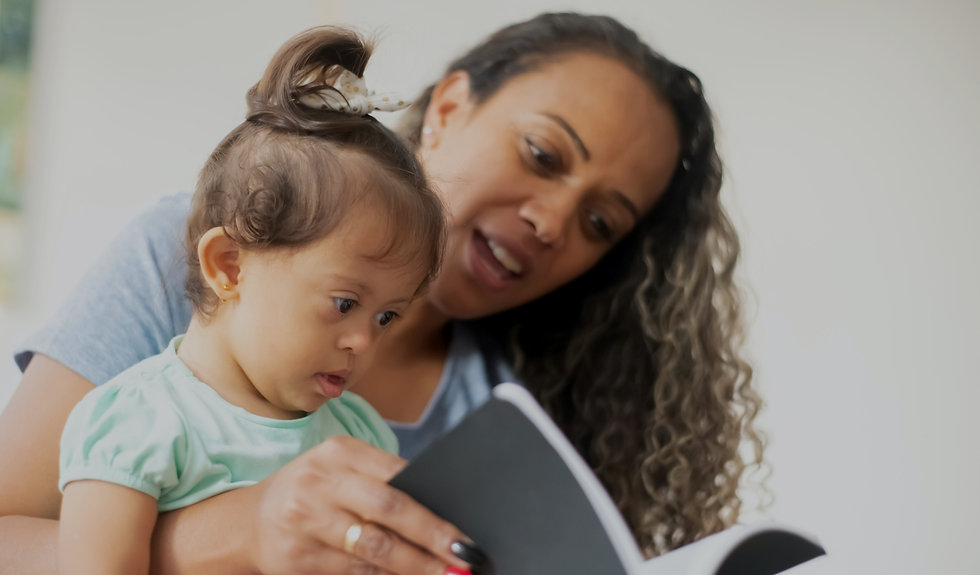 Lady reading a storybook to a child