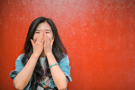 cheerful-ethnic-woman-against-vivid-red-