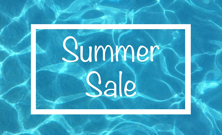Summer Sale text sign on swimming pool w