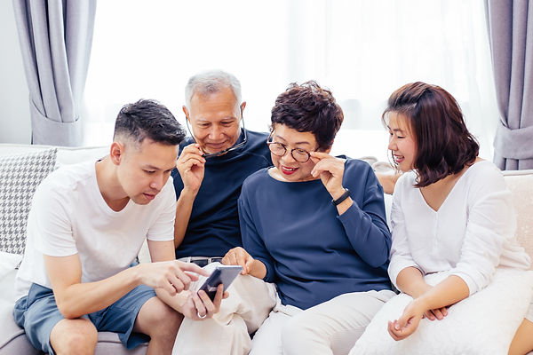 Asian family on mobile phone.jpg