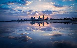 Dusk-Kuwait-City-buildings-sea-clouds_m.